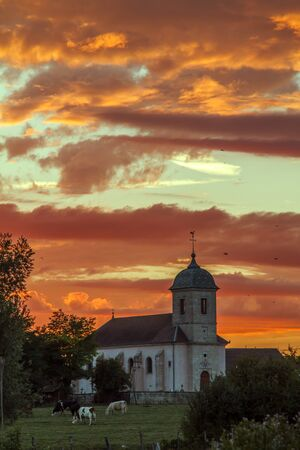 Stunning sunset and a church in France