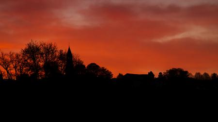 sunrise at Saint-Léonard-de-Noblat, France Reklamní fotografie - 100666513
