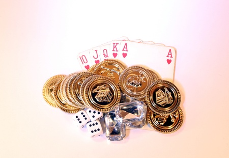 Gold poker chips, diamonds and dice together with a royal straight flush photo