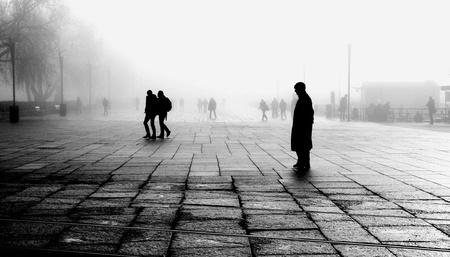 lonelyness: Silhouette of man taking a break in foggy morning