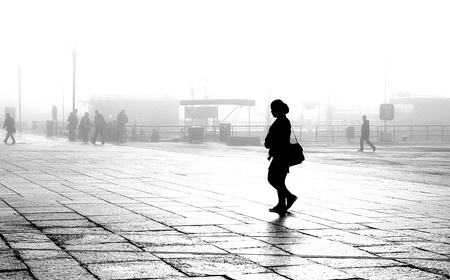 Silhouette of woman walking in foggy morning Stock Photo - 12908390