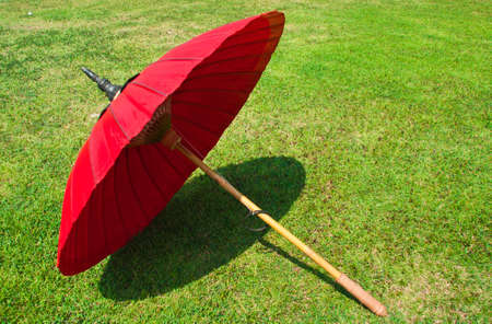 Red umbrella on the lawn  photo