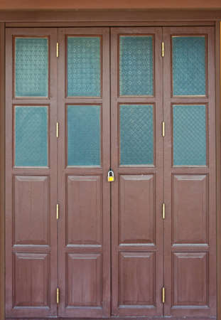 Wooden door set in texture wooden walls photo