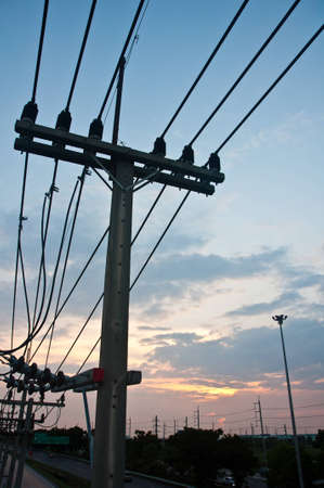 electricity post in the sunrise photo