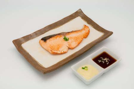 Saba fish grilled on white background photo