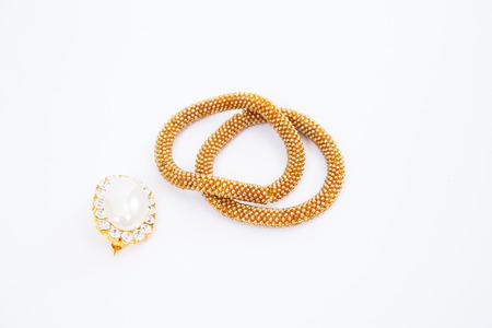 Golden bracelet with diamonds on white background photo