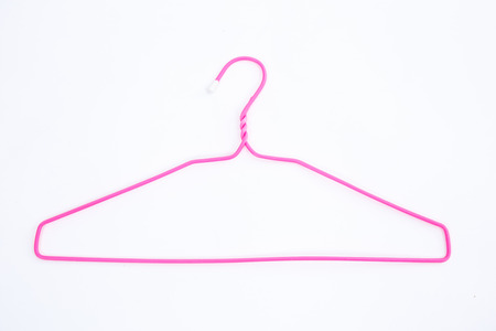closet rod: Pink wire hangers on white background