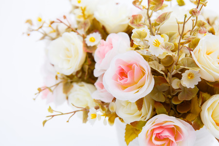 golden pot: flowers in white pots on white background
