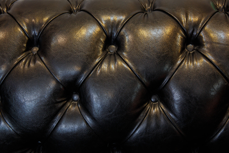 leather sofa: Luxurious Black leather sofa detail close up
