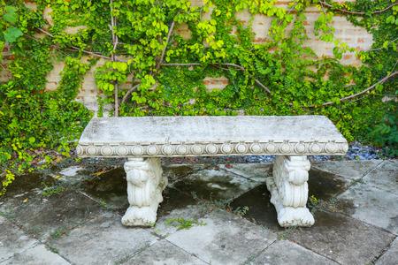 garden bench: Garden Bench Made of stucco stone Stock Photo