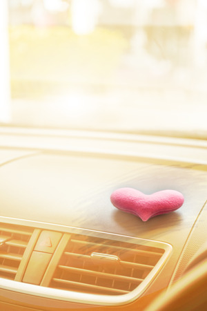 Inside the car with Pink heart with light filter