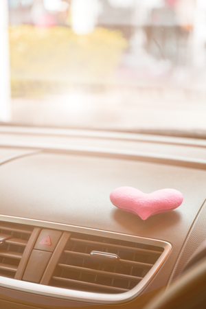 Inside the car with Pink heart with pink light filter