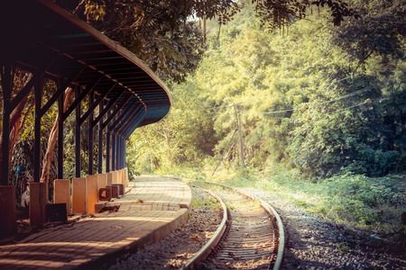 Ancient railway station and big green tree