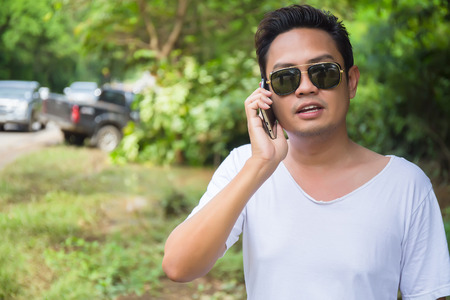 Male Driver Making Phone Call After car Accident Stock Photo