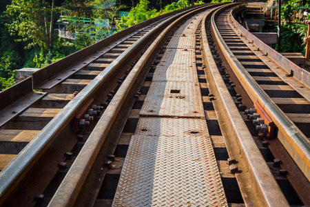 Railroad track curve around a bend Stock Photo