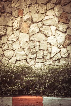 stone background: Texture old rock wall made of random stone background