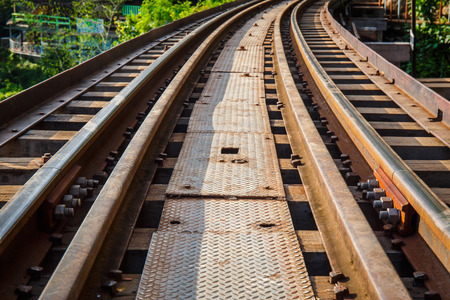 forest railroad: Railroad track curve around a bend Stock Photo