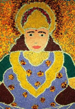 Rangoli made with Dal and coloured rice of an Indian goddess photo