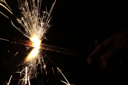 Sparklers (Phooljhari) in a hand on black background on Diwali Stock Photo - 3799605