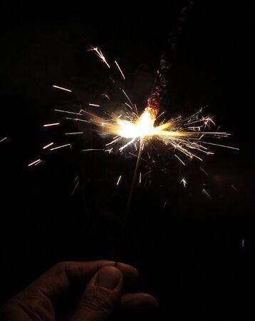 Sparklers (Phooljhari) in a hand on black background on Diwali Stock Photo - 3799602