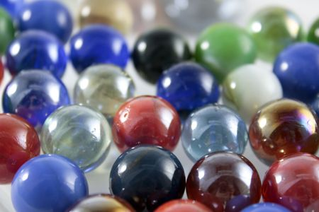 colourful glass marbles on a white background photo