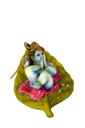Sculpture of lord krishna isolated on white Stock Photo