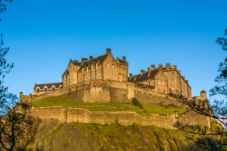 Edinburgh Castle is a historic fortress which dominates the skyline of the city of Edinburgh, Scotland, from its position on the Castle Rock. There has been a royal castle on the rock since at least the reign of David I in the 12th century, and the site c