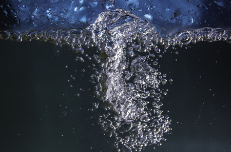 Sparkling bubbles in splashing water.