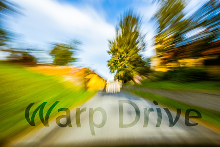 A car speeding down the road that is blurred. photo