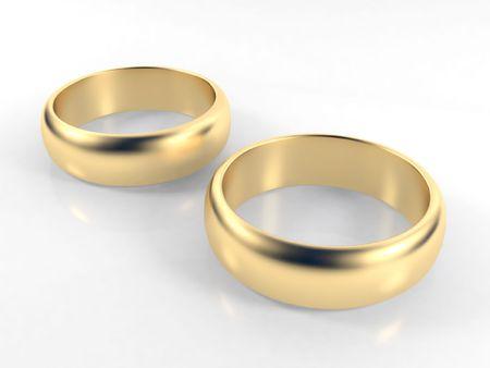 anillo de boda: Aislado compromiso anillos de oro sobre fondo blanco