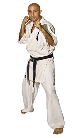 karateka: The serious karateka men is fighting. Path for isolating mask is included Stock Photo