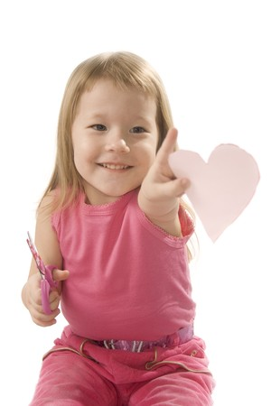 stitchcraft: pretty small girl in red is cutting paper heart shape