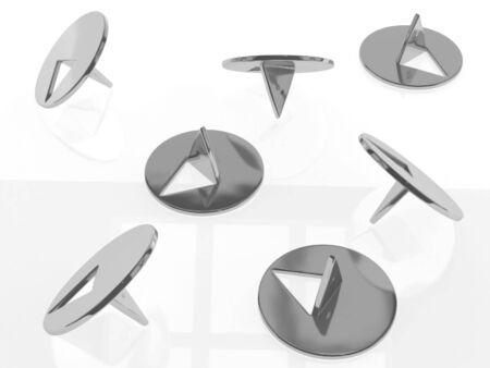 acute angle: The metallic thumbtacks (drawing pins) on white background