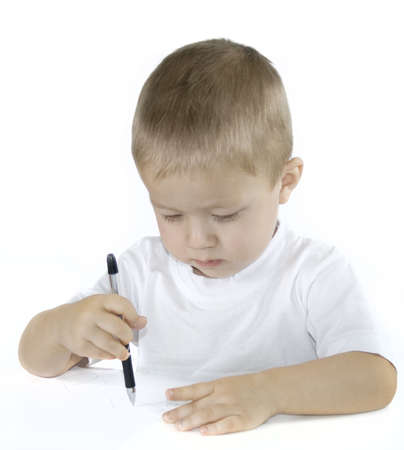 small caucasian boy is drawing isolated on white
