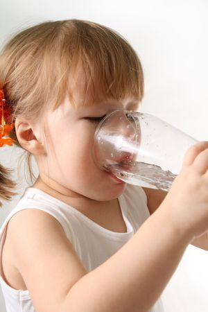 derivative: The small girl is drinking water from glass. Stock Photo