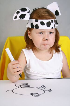 Cute little girl–Dalmatian drawing with markers photo