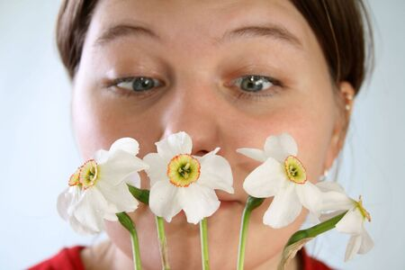 fever plant: A pretty young girl having an allergic reaction to a Narcissus
