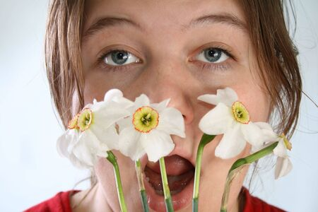 A pretty young girl having an allergic reaction to a Narcissus