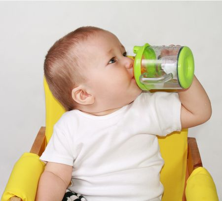 One-year-old  is drincking water. Stock Photo