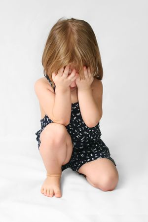 Small caucasion girl with sad expression on his face.