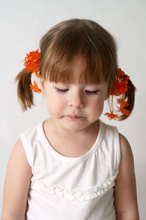 sorrowfully: Small caucasion girl with sad expression on his face.