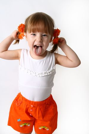 unnatural: Head and hands shot of Little girl sticking out her tongue at the camera for fun
