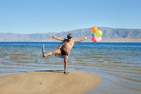comically: Happy absurdly Infantile man at vacation on sunny beach
