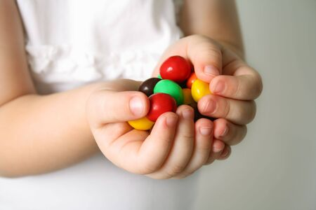 Bubble Gums in the hands of the small girl