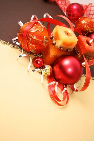 Frame from christmas ornaments. Isolation on yellow and brown photo