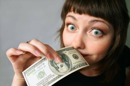 Woman with hand of money, looking stupid with herself Stock Photo