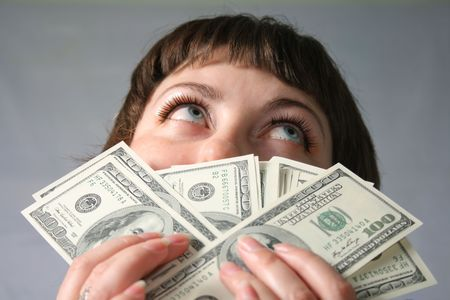 Woman with hand of money, looking stupid with herself photo