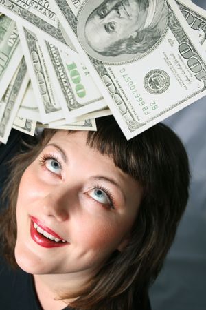 Woman with hand of money, look up with herself on a Black background.  photo