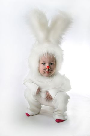 little girl in a white downy bunny costume. photo