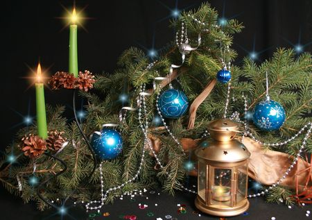Attributes of Christmas - lamp, cone, beads, candle, garland, balls, tree, paper streamer photo